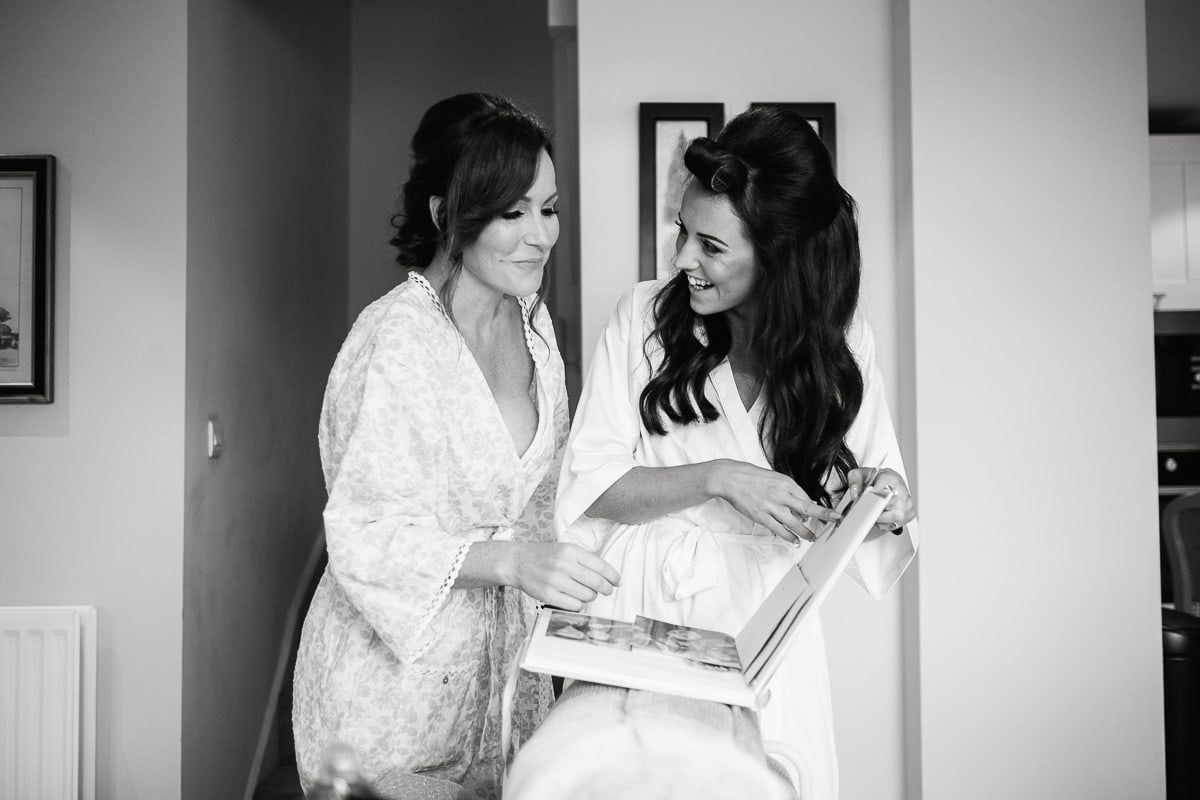 bride and sister laughing