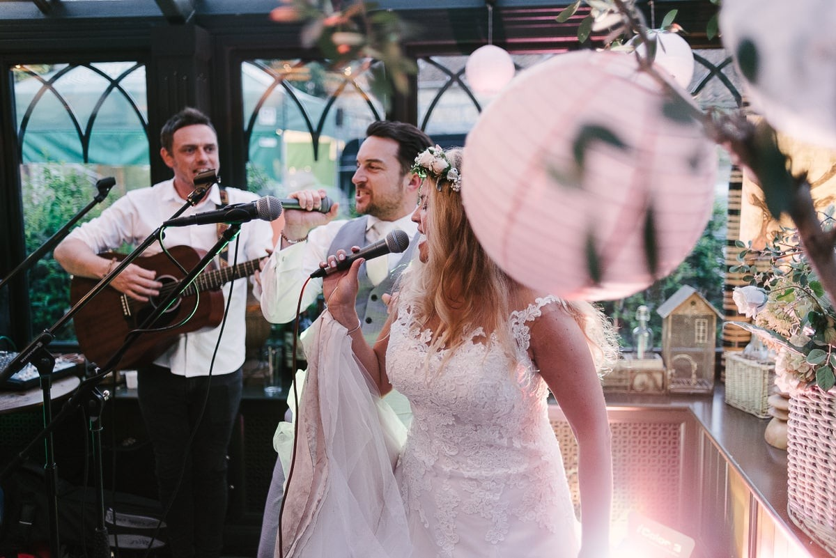 bride and groom join the band