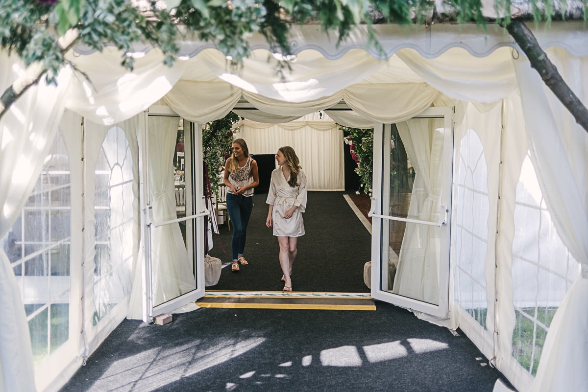 Yorkshire Wedding Photography inspecting the marquee